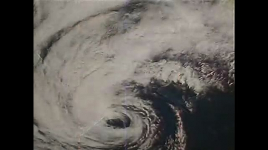 UNITED STATES: 1990s: coriolis effect in hurricane above Earth
