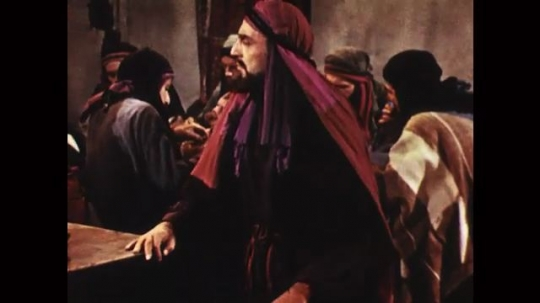 UNITED STATES: 1950s: Judas and Jesus exchange glances across room