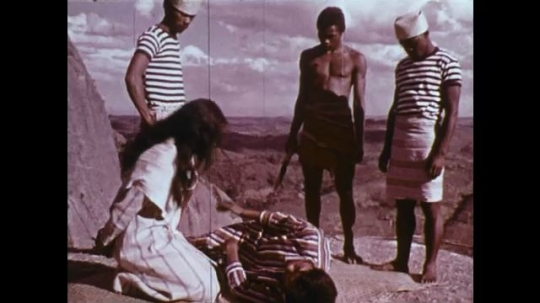 MADAGASCAR: 1970s: girl hugs man on edge of cliff.