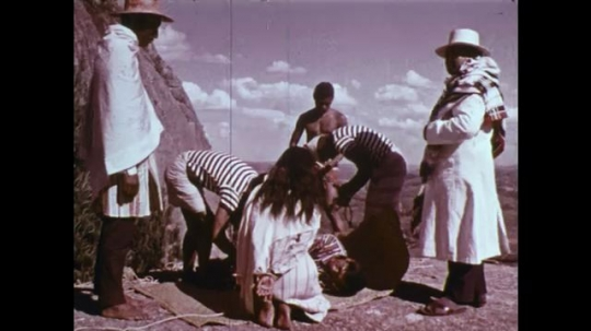 MADAGASCAR: 1970s: men tie man before execution. Man buys girl. Girl untied.