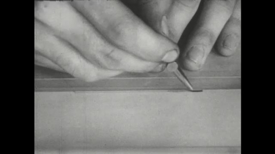 UNITED STATES: 1960s: close up of pencil drawing on paper. Eraser deletes line.