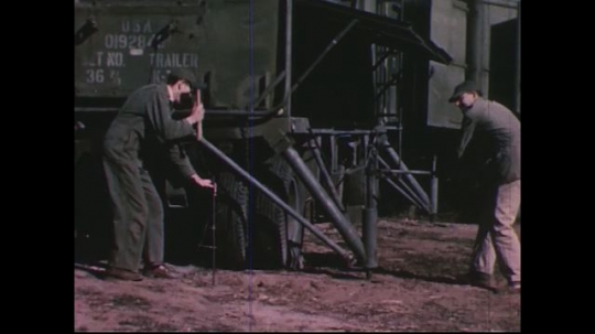 UNITED STATES 1950s: Soldiers position military equipment / Scientist climbs on radar truck / Scientist sits at radar equipment / Man walks up to cave / Man at cave entrance.