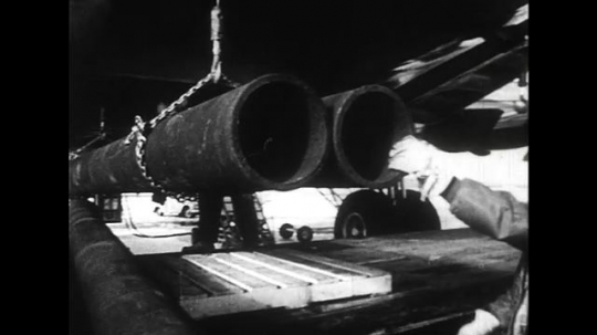 ALASKA 1960s: After an earthquake, irrigation pipes are brought in to Alaska and typhoid vaccines administered.