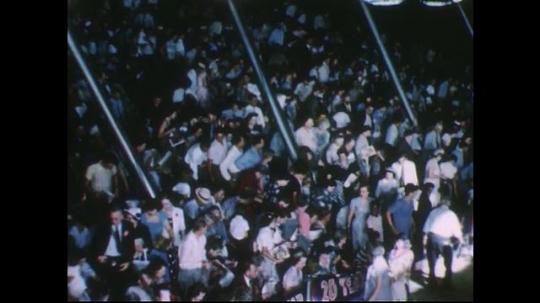 UNITED STATES 1950s: Views of crowd getting up, walking out of circus.