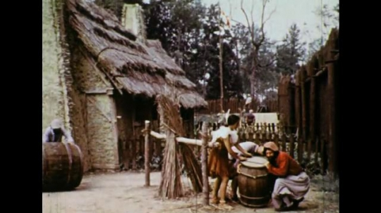 UNITED STATES 1600s: Colonists roll barrels in fort / Colonial man with Native American woman.
