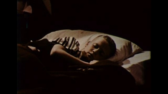 UNITED STATES 1950s: A boy sleeps soundly at night.