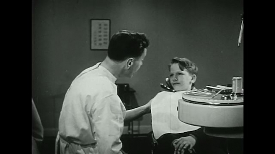 UNITED STATES 1940s-1950s :A dentist informs a young boy about the best times to brush teeth.