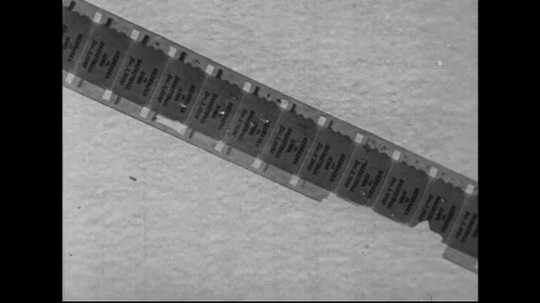 1940s-1960s : A section of a film is damaged as the sides have fallen off.