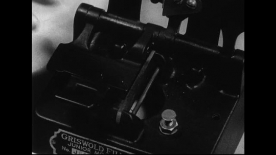 1940s-1960s : A film is placed on the left side of a splicer, cut, moistened, scraped, and brushed.