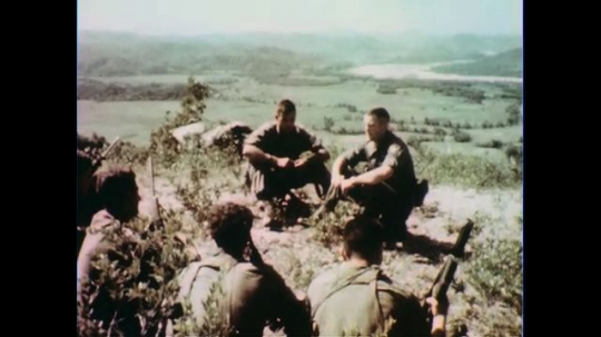 VIETNAM 1960s: Officers talk to soldiers.