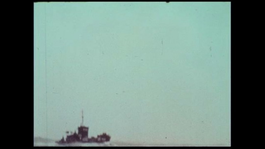 UNITED STATES 1970s: A small tugboat tries to fight off the roaring seas.