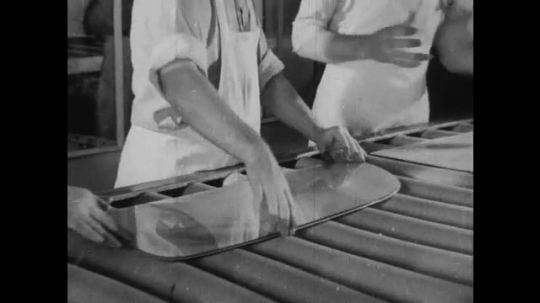 UNITED STATES 1930s-1940s : Workers in a factory assemble two paned safety glass shields for cars. An aerial view of Henry 's River Rouge factory/plant.