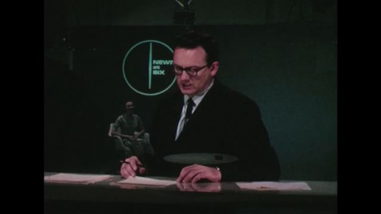 UNITED STATES 1960s: A man reports on television.