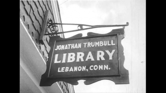 UNITED STATES 1950s: Sign for Trumbull Library / View of baptist church / View of small synagogue.