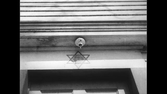 UNITED STATES 1950s: Star of David on synagogue / View of Catholic church / Sign outside Catholic church / Pan down town hall / Field, historic marker.