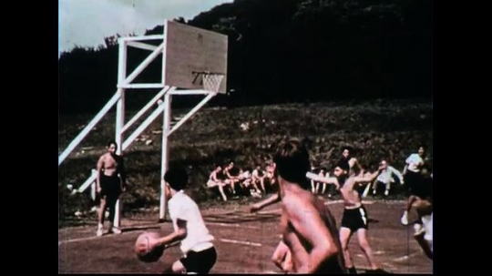 UNITED STATES 1970s: Children playing basketball, football, and sliding in snow.