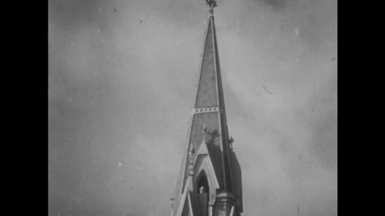UNITED STATES, 1940s: Church steeple in clouds. 'The End' credits.
