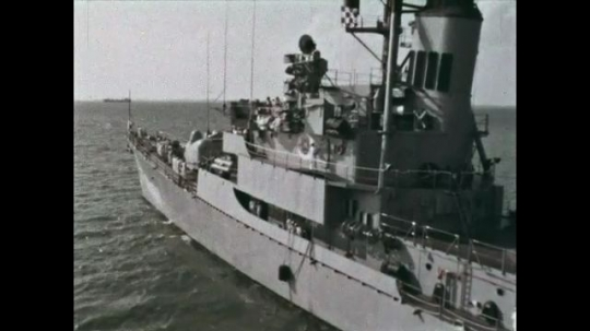 UNITED STATES: 1968: military ship on water. Mast of ship. Officers on bridge of ship.