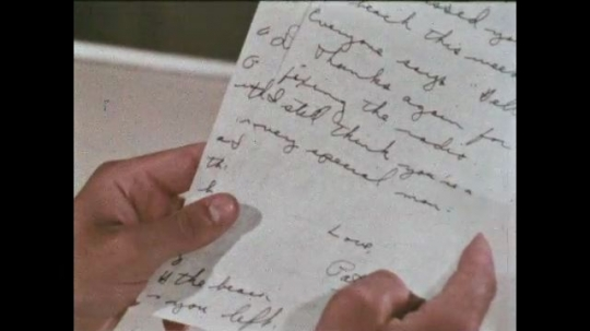 UNITED STATES: 1968: sailor at sea reads letter. Title credit.