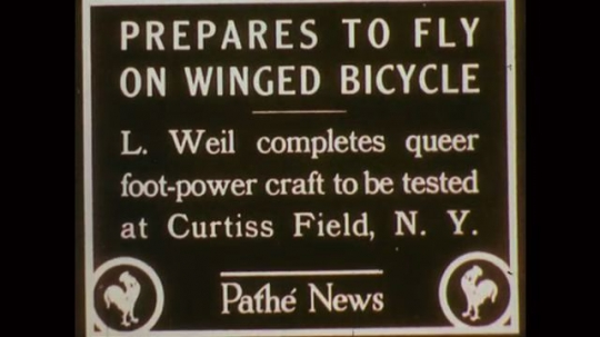 1890s: News for test of flying contraption. Man pedals contraption to make wings flap in and out. Man steers contraption. News poster for invention. Man pedaling a two-wheeled, winged contraption.