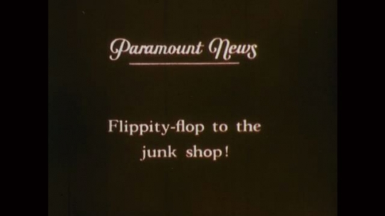 1890s: News title. Man in winged vehicle. Men guide wheeled contraption with wings along field. Man jumps off building with winged contraption, falls. Man puts wheels under wings. Airplane flies.