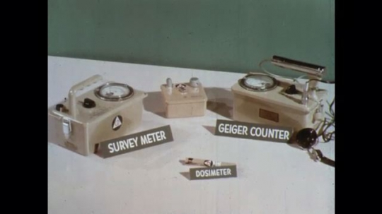 UNITED STATES: 1960s: survey meter, dosimeter, and  Geiger counter on table