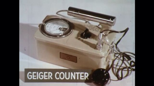 UNITED STATES: 1960s: close up of Geiger counter on table. Survey meter on table.