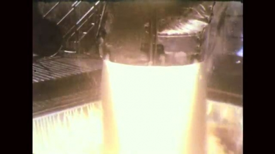 UNITED STATES: 1960s: close up of flames beneath rocket. Rocket structure.