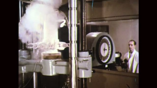 UNITED STATES: 1960s: man works in science lab. Danger Liquid Nitrogen sign.