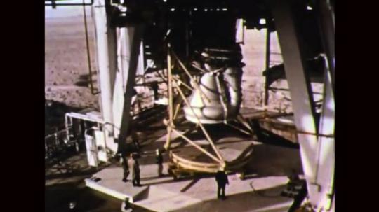 UNITED STATES: 1960s: men work on space rocket build. Rocket scaffolding
