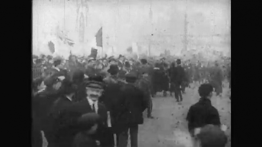 UNITED STATES: 1910s: people celebrate in street as war ends.