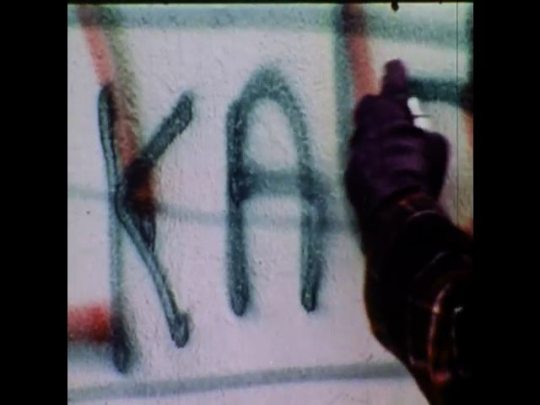 UNITED STATES 1970s: People creating graffiti on walls and a young man trying to scrub it off.